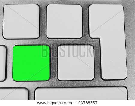 Close-up of laptop keyboard with color button