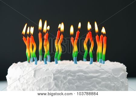 Birthday cake with candles on dark background
