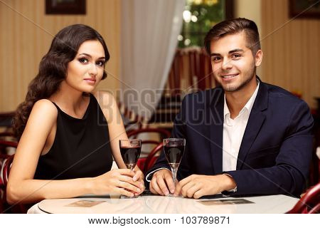 attractive young couple dating at the restaurant