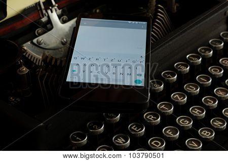Mobile Phone on Old Typewriter