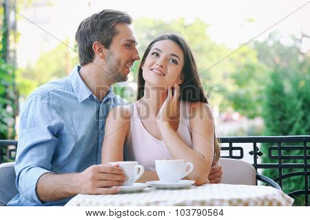 Young couple in street cafe