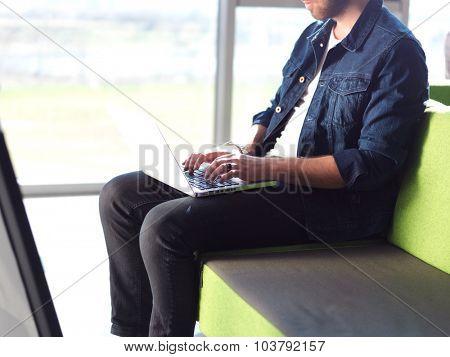 student working on laptop computer at university school modern interior