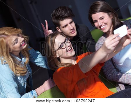 happy students group taking selfie with smartphone and tablet computer