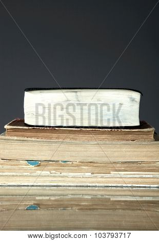 Stack Of Old Books On Dark