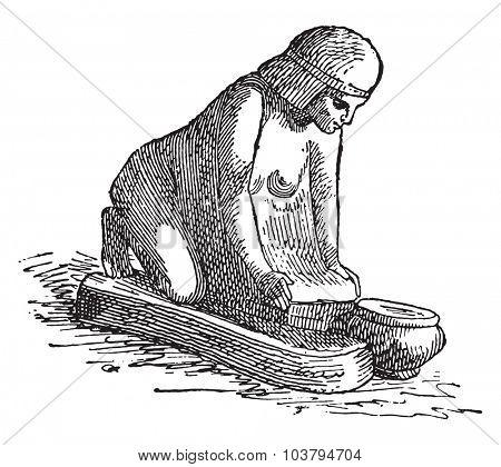 Woman kneading bread, vintage engraved illustration.