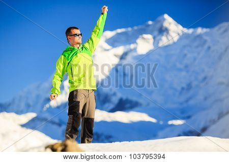 Man hiker or climber accomplish in winter mountains inspiration and motivation achievement business