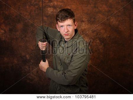 Man With Katana Sword On Brown Batik  Background
