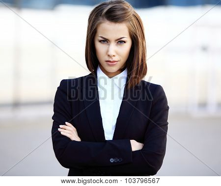 Portrait Of A Successful Business Woman Smiling. Beautiful Young Female Executive In An Urban Settin