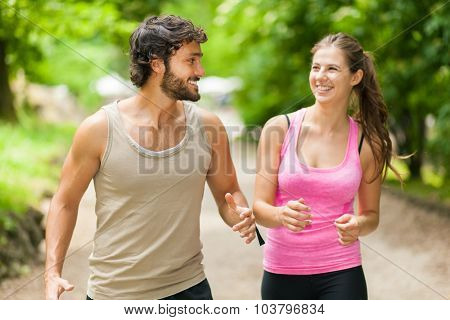 Couple running in a park