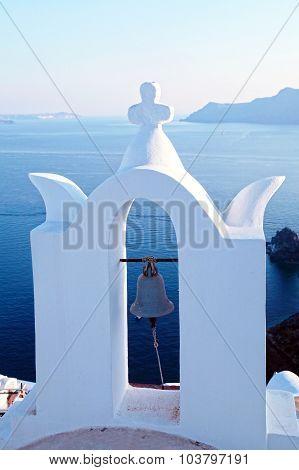 Bell Tower Of White Church Above The Beautiful Blue Sea, Oia, Santorini, Greece.