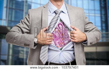 Man showing an euro banknote under his shirt