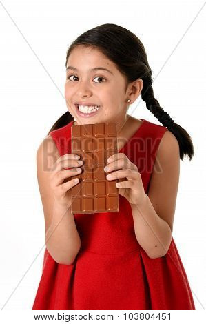 Hispanic Female Girl Wearing Red Dress Holding With Both Hands Big Chocolate Eating In Happy Excited
