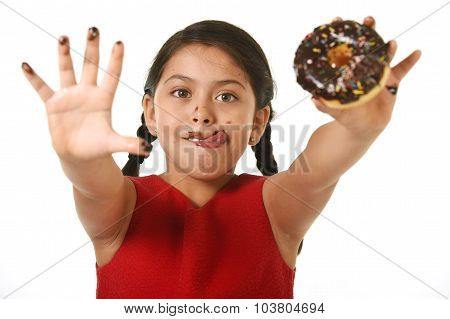 Latin Female Child In Red Dress Holding Chocolate Donut With Hands And Mouth Stained And Dirty Showi