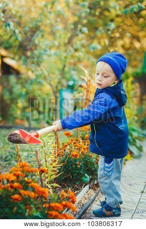 Portrait Of A Boy Working In The Garden