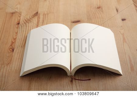 open book on the brown table