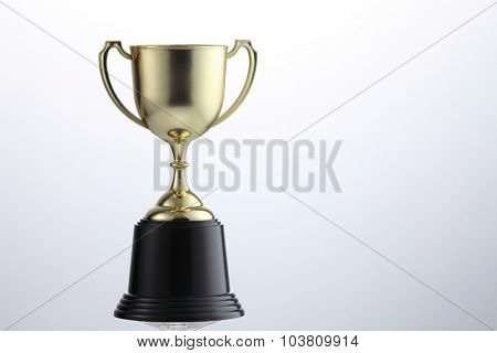 golden cup trophy isolated on white background