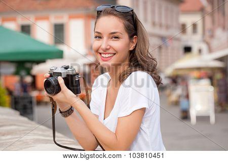Brunette Beauty Taking Photos.