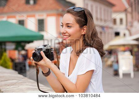 Brunette Woman Using Analog Camera.