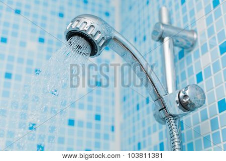 Head shower on blue background