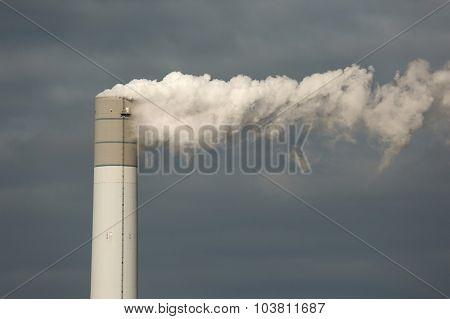 Smoking power plant chimney closeup