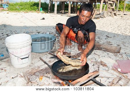 Man processing sea cucumber