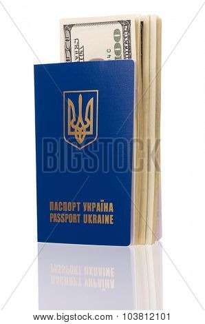International Ukrainian passport with US dollars banknotes, isolated on white background