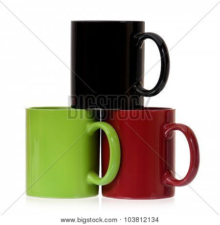 Three empty cups for coffee or tea, isolated on white background