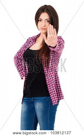 Beautiful girl holding up her hand to say stop, isolated on white background