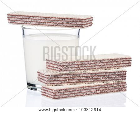Glass of milk with waffles isolated on white background