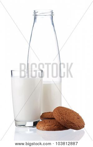 Bottle of milk and glass with cookies isolated on white background