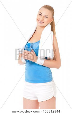 Young fitness woman with towel and bottle of water, isolated on white background