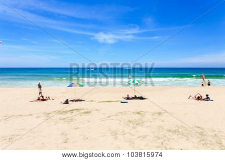Blurred Image : Tourists At Karon Beach In Phuket Island, Thailand