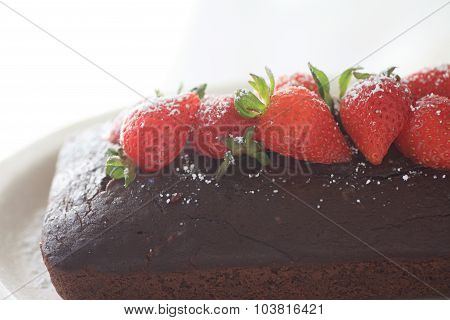 Chocolate cake and strawberries with copy space