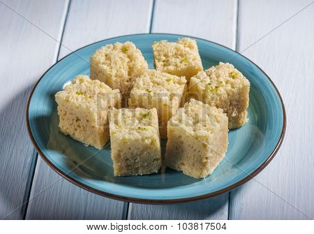 Mysore pak - an Indian sweet presented in a blue plate.