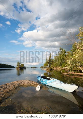 Kayak On Northern Lake At Dusk