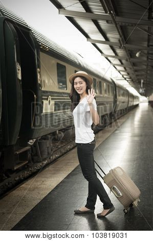 Shot Of A Beautiful Young Asian Woman Traveling Pulling A Luggage