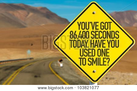 You've Got 86,400 Seconds Today. Have You Used One to Smile? sign on desert road