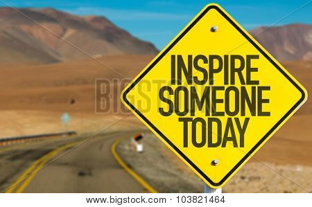 Inspire Someone Today sign on desert road