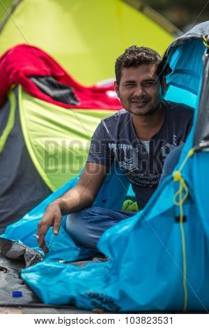 KOS, GREECE - SEP 28, 2015: War Refugee in tents. More than half are migrants from Syria, but there are refugees from other countries -Afghanistan, Pakistan, Iraq, Iran, Mali, Eritrea.