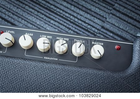 Button Of Guitar Power Amplifier, Closeup View Background