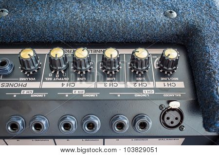 Button Of Keyboard Power Amplifier, Closeup View Background