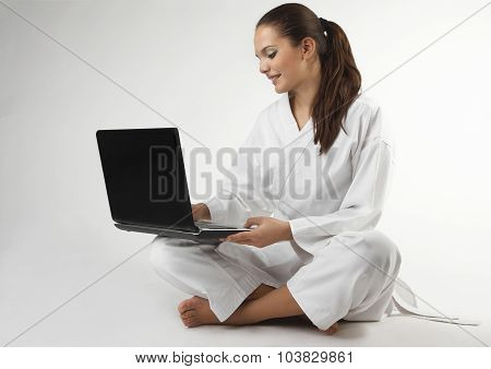 Attractive Young Sexy Women In A Karate Pose With Notebook