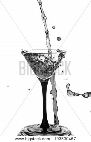 Cocktail Glass With Splashes On White Background.