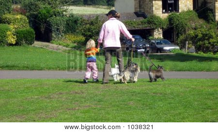 Woman Going Out With Her Daughter And Dogs
