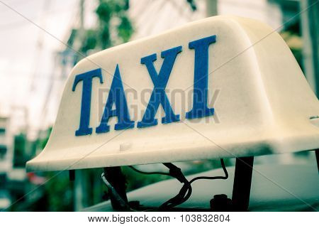 Old taxi sign on roof top car