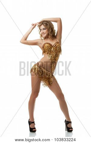 Coquettish fair-haired woman dancing in studio
