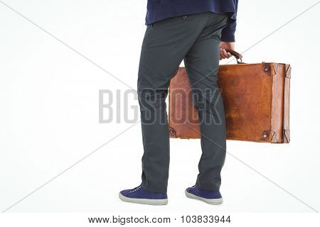 Low section of man with briefcase standing over white background