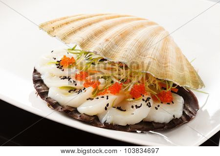 scallops presented on a scallop shell
