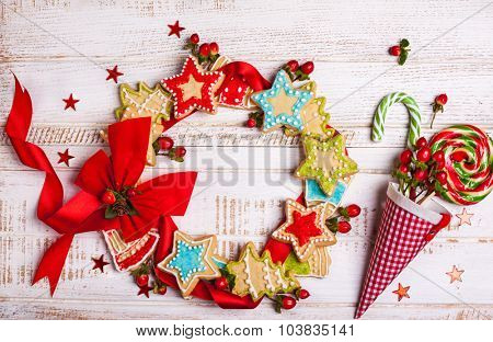 Christmas cookies and candy canes on wooden background