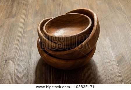 empty wooden bowls on table